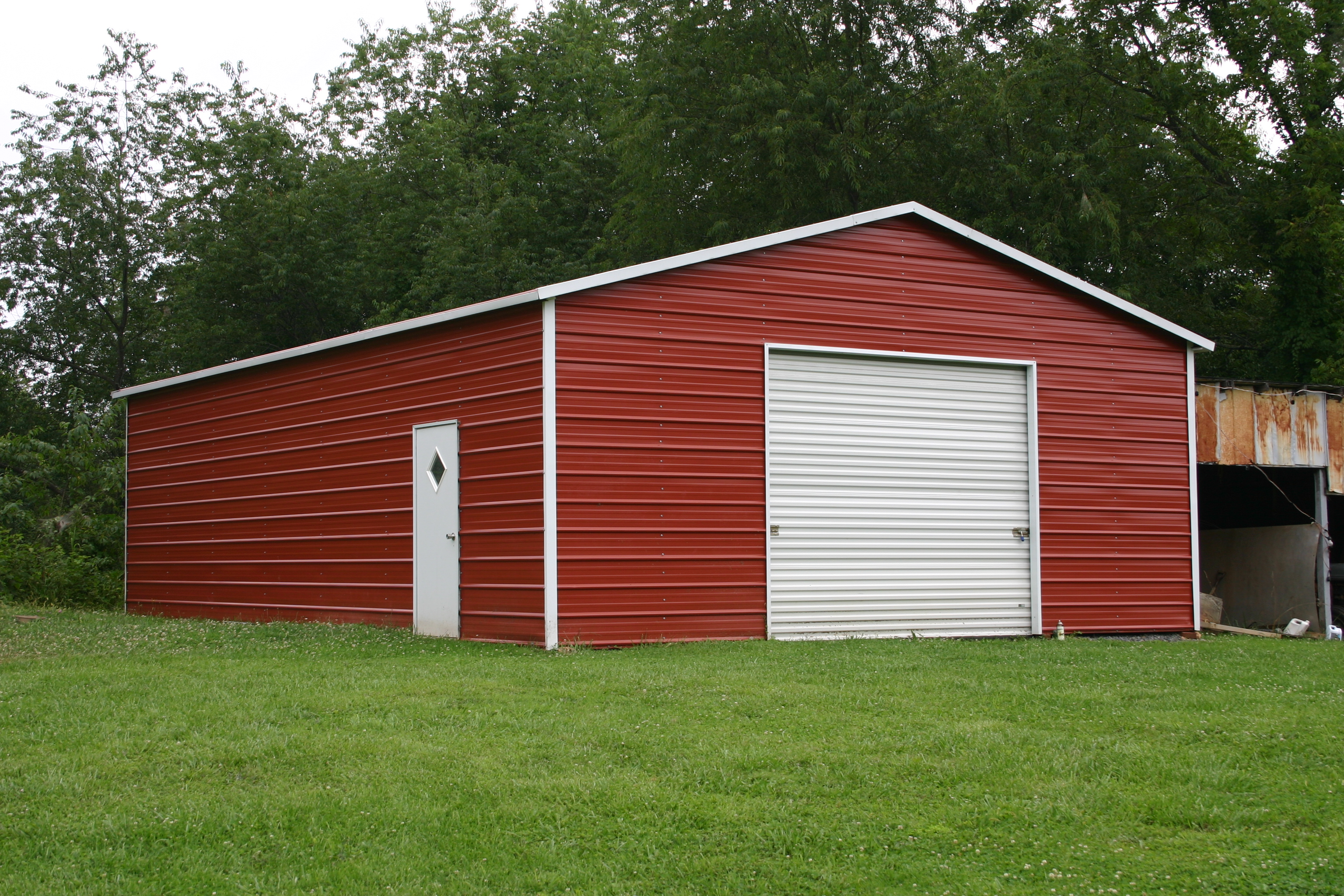 Metal carports halls crossroads tn halls crossroads for Garage and carport