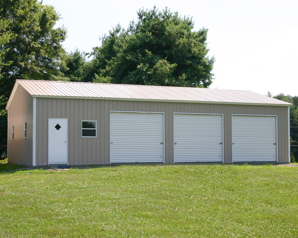 Triple car garage triple car garages for Garage building packages