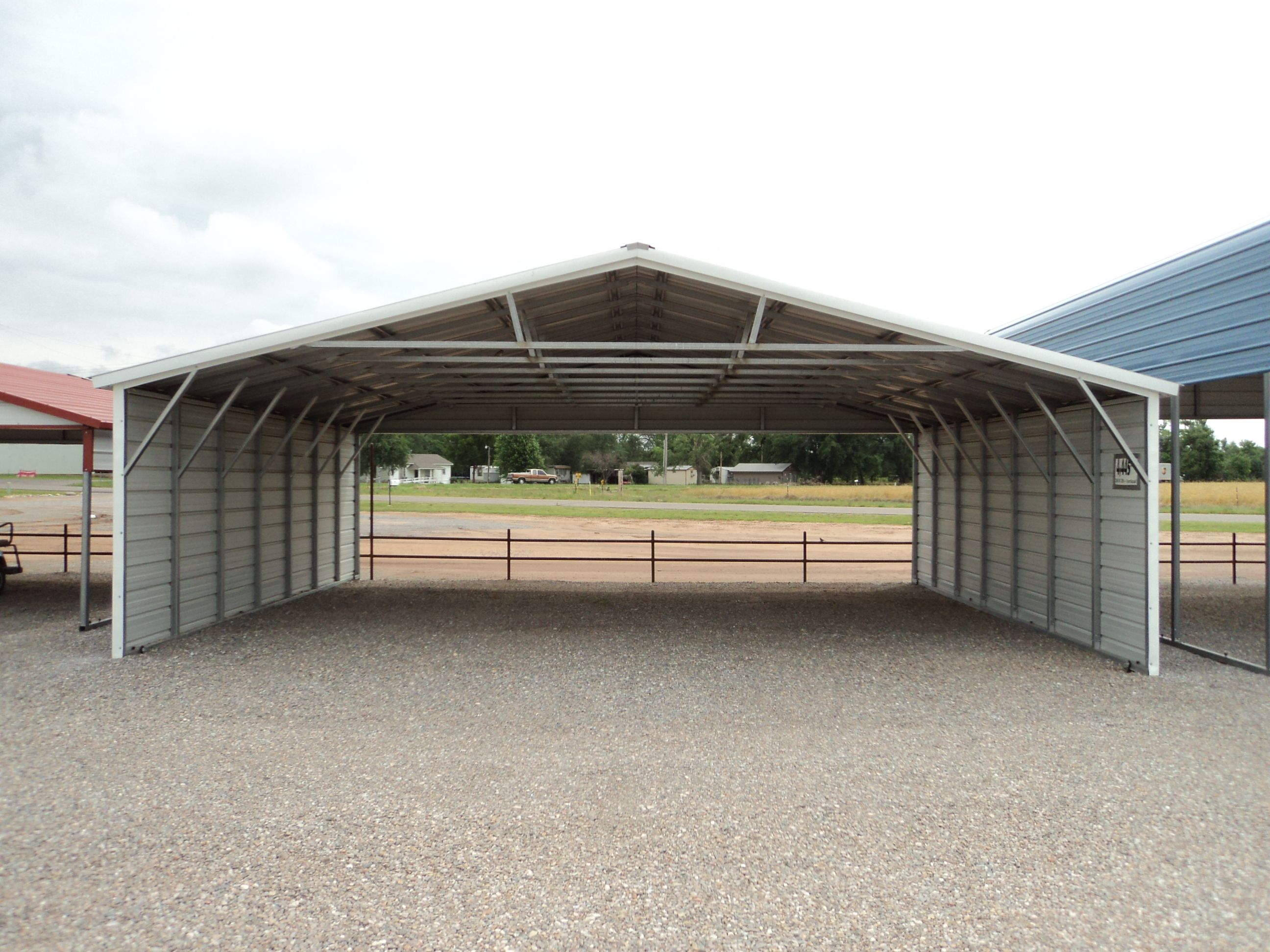 Vertical Roof Triple Wide Carport